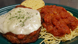 CHICKEN PARMESAN - Breaded and Deep-fried to Golden Brown & Served with a Bed of Pasta & Garlic Bread