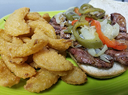 RIBEYE STEAK SANDWICH - A Thicker Cut of Ribeye and Grilled Peppers & Onions